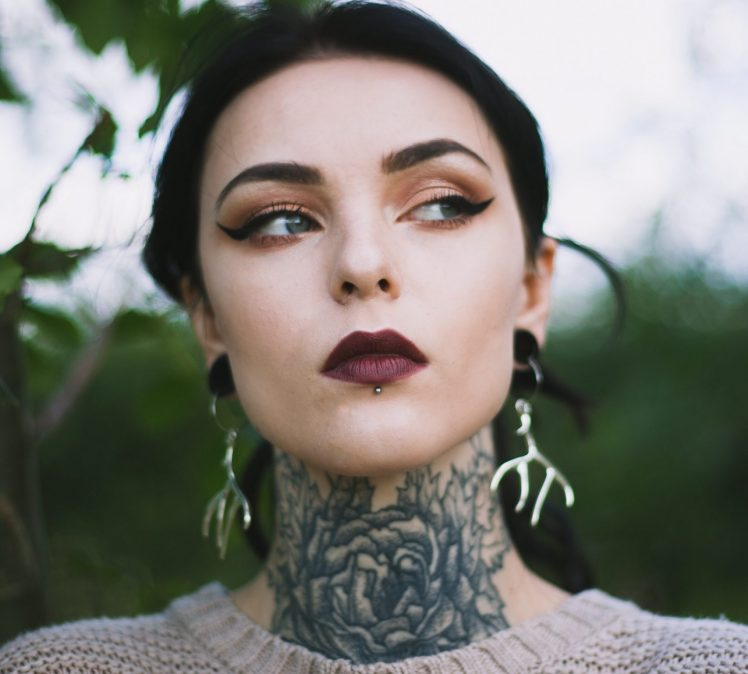 The Right Tattoo For Your Long Neck